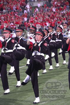 The band doing chair step during pregame performances.