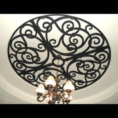 I love this look, but you can do it cheeper if you repurpose the metal art and use it has a ceiling chandelier medallion.