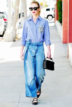 Kate Bosworth wears a button-up blouse with wide-leg denim, black flats and a black patent bag.