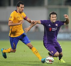 Sergi Busquets (L) of FC Barcelona competes for the ball with Giuseppe Rossi of ACF Fiorentina during the preseason friendly match between ACF Fiorentina and FC Barcelona at Artemio Franchi on August 2, 2015 in Florence, Italy.