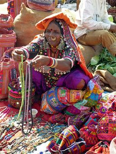 INDIA: Mapusa market Goa. Necklaces here are really from Goa but the woman is dressing >Banjara fashion that is from northern India.