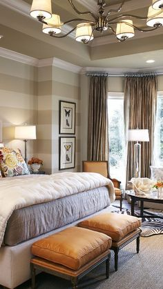 Soft shades of grey bedroom design with great pops of tan - love the subtle horizontal striped walls
