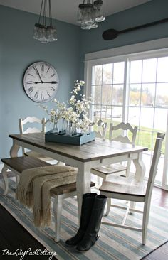 Dining area - the lily pad cottage. Love the two-toned table with bench!