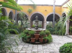 The outer covered hallway with arches accent this central courtyard...many hacienda style courtyards will have water and fruit trees and herb gardens