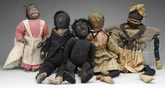 """FOLK ART BLACK DOLLS. Includes three cloth dolls, one composition Mammy doll and grotesque hanger doll with three primitive clothes pins. SIZE: Largest is 24"""" h.   Link here: http://jamesdjulia.com/auctions/div_catalog_311.asp?pageREQ=2"""