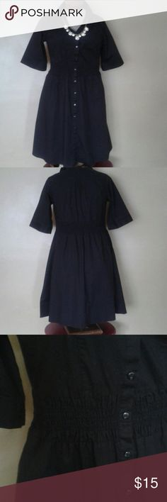 Lane Bryant Shirtdress black size 16 Euc great basic dress with short sleeves, elasric waist and elastic smocking in the front shoulder area. The dress has two front pockets and is not lined. It has front button closure. Waist (unstretched) ca. 36 inches, bust 42 inches, length ca. 41 inches. The size and material label has been cut out, but according to the Lane Bryant website the measurement translate to a size 16. The material is a medium weight poly/cotton blend. Lane Bryant Dresses