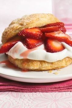 Fresh strawberries and whipped cream with fluffy biscuits sound like summer!