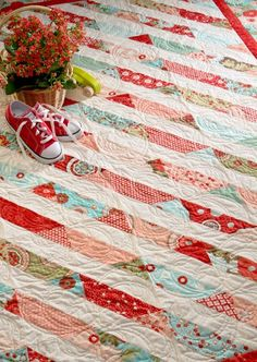 red and aqua. Jelly roll strips cut into triangles.