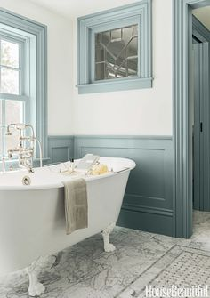 """COLOR  Back in the 18th-century when this Massachusetts farmhouse was built, there was no such thing as a master bath. So architect Michael T. Gray and interior designer Hattie Holland carved one out of a hallway and added wainscoting and window casings to create a sense of the past. The color """"has a historic feeling with that gray cast,"""" Holland says."""