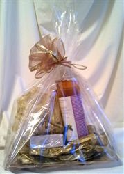 """This gift basket of high quality French bath products on the beautiful Capiz shell plate contains: 1 square Capiz shell plate 8"""" x 8"""" 1 200 g bottle of Lavender fragrance bath salt 1 250 ml bottle of Lavender-Mint fragrance shower gel with Marseille liquid soap 1 100 g Lavender fragrance Marseille soap bar 1 pouch with 3 lavender heart shape soaps (25 g each)"""