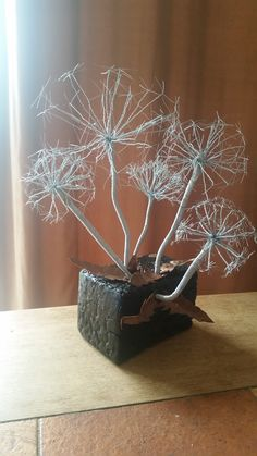This sculpture is now called a walk in the woods and has a fairy in its midst. Made in Steel wire and mounted on to forged Oak. I also made the leaves from recycled copper sheet. Copper Sheets, Project Ideas, Projects, Walk In The Woods, Incense, Dandelion, Recycling, Sculptures, Fairy