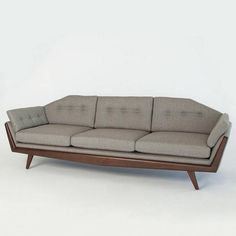 The Greta Sofa is an ode to midcentury modern design with a classic twist. Pairing walnut with neutral, solid-colored fabric or soft leather is the key to freshness.