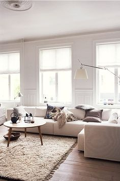Linen Roman Shades allow the light to filter in but block the vastness of the windows.