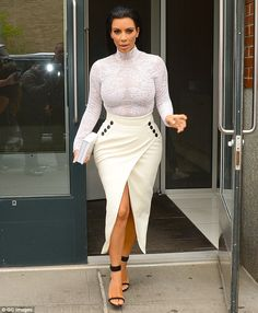 Making a bold exit: Kim Kardashian is seen leaving her New York apartment on Tuesday, the morning after her red carpet turn at the Met Gala