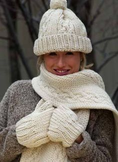 This beautiful free knitting pattern to make a matching hat, scarf and mittens involves smooth stockinette, ribs, and cables. Bulky wool makes it all very warm and cozy.