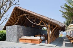 naman-retreat-beach-bar-vo-trong-ngia-architects-vietnam-he stone walls function as structural support for the bamboo roof