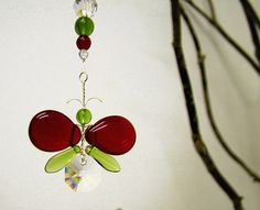 This gorgeous Red and Green butterfly suncatcher / car charm has been hand crafted from Swarovski crystal & glass beads. Each butterfly has its