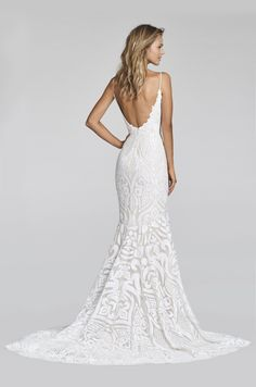 Ivory Marrakesh beaded fit to flare bridal gown, sweetheart neckline with spaghetti straps and low scoop back, elongated bodice with ivory embellishment over ca