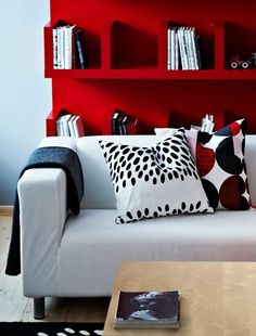 EKTORP sofa in front of a red shelf.