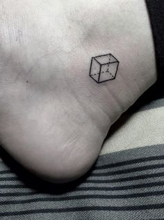 See-through cube tattoo