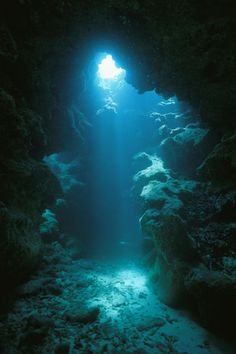 A beam of sunlight illuminates an underwater cave. by National Geographic