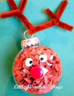 Reindeer Ornament ~ I shredded a few sheets of brown paper and the kids stuffed clear glass ball ornaments with it. Then, I helped them dip a finger in red acrylic paint for the nose and white for the eyes.For the antlers, cut a brown chenille stem in half. Wrap one half around the top and cut the second half in half again to make the rest of the antlers.