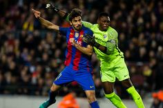 The FC Barcelona player Andre Gomes from Portugal against The Malaga CF goalkeeper Carlos Kameni from Camerun during the La Liga match between FC...