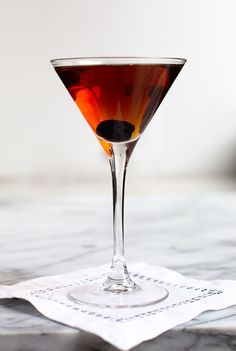 Adapted from the 1956 edition of the Esquire Drink Book, this aromatic cocktail—equal parts rye, sweet vermouth, and dry vermouth—is sweet without being syrupy. Garnished with a maraschino cherry, it's the perfect post-dinner drink.