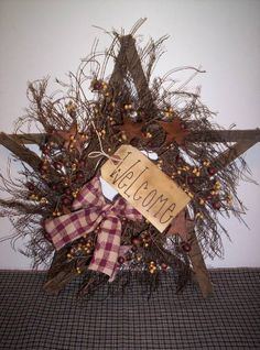 This star primitive wreath is one of my top sellers. It has a very nice primitive look. You can sit it on a shelf or hang it on the wall. It will have burgundy and tan berries with a grungy tag. Measures 15 x 15 Primitive Wreath, Primitive Homes, Primitive Crafts, Primitive Christmas, Country Primitive, Rustic Christmas, Christmas Wreaths, Christmas Decorations, Primitive Stars