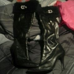 Faux leather knee-length high boots Size 7 so leather 3 inch heel hardly ever worn come right below your kneecap got fur or fake fur on top a little while bling on the outer part of the if there's anything else you like to know get back to me and I will assist you in any way I can thank you and have a great day London Shoes