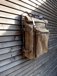 Waxed canvas backpack with roll to close top and vegetable tanned leather…