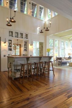 The high ceiling in this kitchen with double windows, brings in so much light. Love the idea of this space.