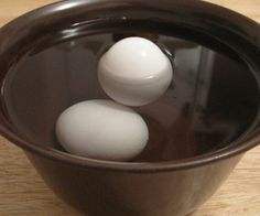 Cooking Hack Every Chef Should Know: A very fresh egg will sink to the bottom and lay on its side. A week old egg will be on the bottom with pointy end on top.  Three week old eggs will be balanced with fat end sticking up. Bad eggs will be floating.