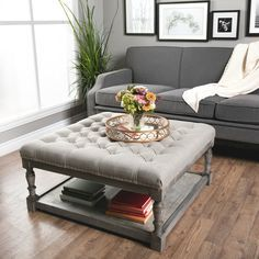 This beautiful Creston square ottoman features comfortable, durable fire retardant foam cushioning, solid wood framing in a reclaimed finish and versatile storage tray. Upholstered in rich beige linen fabric, this ottoman if finished with button tufting.