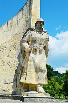 The Romanian soldier monument, in the park, against the blue sky, in the city of Baia Mare, next to Sasar river, the capital of Maramures County.