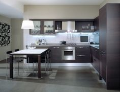Metal cabinets, wood fronts, white solid surface, gray floor.