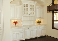 arch inset cabinet with furniture feet, glass panes, lighting, plate rack, beadboard, molding