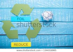 Recycle concept showing the green recycle logo with foil & reuse on a blue weathered background Sales Image, Green Logo, Logo Images, New Pictures, Logos, Royalty Free Photos, Background Images, Reuse, Create Yourself
