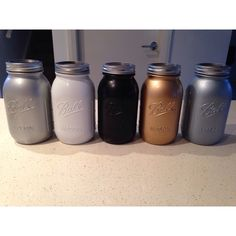 My spray painted mason jars .