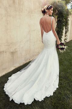 Beautiful lace wedding dress with diamante-adorned shoulder straps, a sexy low back, and an elegant chapel train. Essense of Australia, Spring 2015
