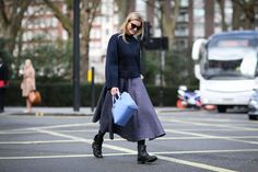 70 Style Lessons From The Streets Of London #refinery29  http://www.refinery29.com/2015/02/82710/london-fashion-week-2015-street-style#slide-55  Maximize your full skirts for daytime by pairing them with more rugged boots.Roksanda skirt, Jimmy Choo bag.