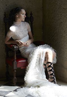LOOK 1, NIGELLA - Ivory paisley rose lace gown with an overlay of light ivory French tulle with lily lace that is accented with dahlia lace godets and intricate pearl, crystal and flower embroidery.
