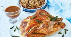 Curtis Stone's roast turkey with sage-brown butter gravy and currant-pine nut stuffing Vegetarian Christmas Main, Curtis Stone Recipes, Christmas Stuffing, Pine Nut Recipes, Christmas Lunch, Christmas 2017, Christmas Ideas, Feeding A Crowd, Roasted Turkey