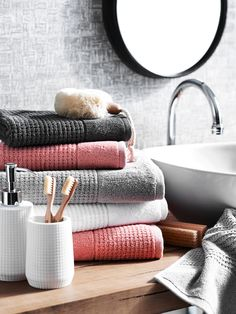 In detail the timeless texture and contemporary hues Bathroom Towel Decor, Bathroom Colors, Bathroom Styling, Small Bathroom, Coral Bathroom Decor, Bathroom Ideas, Bath Towel Storage, Bath Towels, White Bathroom Accessories