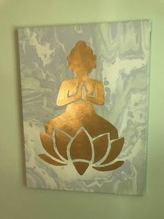 18 x 24 in. Wrapped Canvas Multi Media painting using heavy body acrylic, flow medium, and gold acrylic. Features a beautiful golden Buddha and lotus on a yellow, white, green, and blue marbled background. Photos feature this painting in several different lightings. Any questions feel