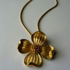 "Vintage Trifari flower pendant necklace In absolutely beautiful vintage condition.  Picked this up at an antique store in my town's historic district, but I've never worn it.  Chain is 18"".  Spring ring sticks slightly but is not broken and functions fine. Trifari Jewelry Necklaces"