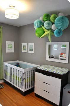 Paper lanterns used to create a feature in this contemporary nursery. Could use lots of round white ones in different sizes to create clouds.