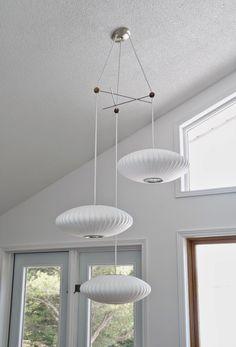 via Dans Le Lakehouse   Modernica's George Nelson Bubble Lamp pendants and triple fixture