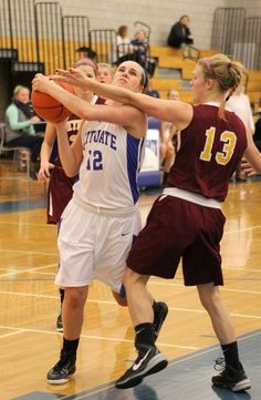 Scituate senior Isabelle Otto is defended by Weymouth senior Kate Farrell during their tournament game at Quincy High School on Tues., Dec. 29, 2015.