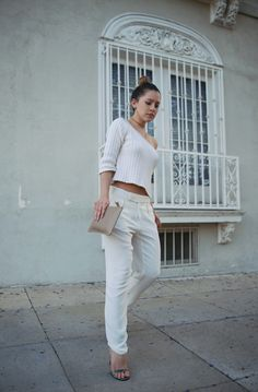 silk pants by Rebecca Taylor, Gucci sandals, and gold jewelry from collaboration with eLuxe